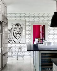cococozy white kitchen subway tiles dark black grout subzero refrigerator tiger art print stainless dwr stools miles redd