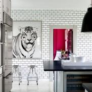 cococozy white kitchen subway tiles dark black grout subzero refrigerator tiger art print stainless dwr stools miles redd
